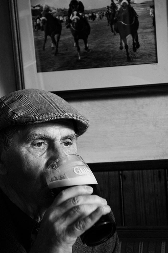 Irishman drinking guinness